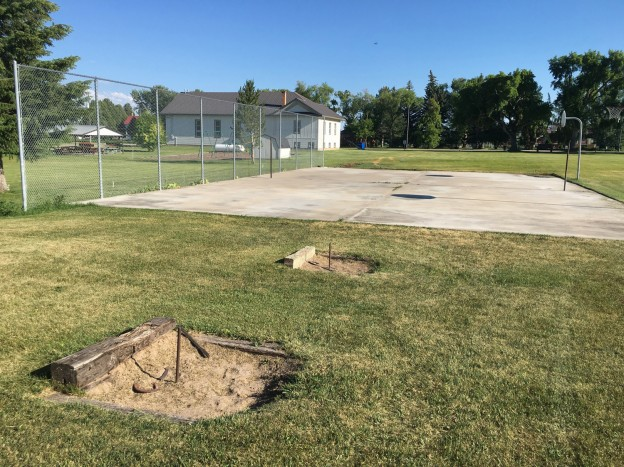 Horse shoe pits and basket ball court